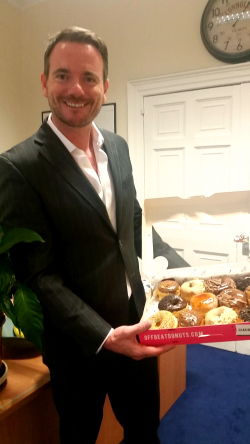 Director Gerard with a box of doughnuts